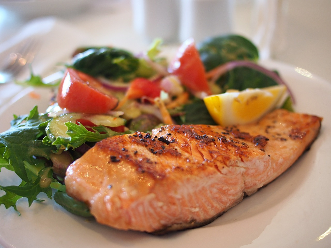 salmon entree on plate with vegies